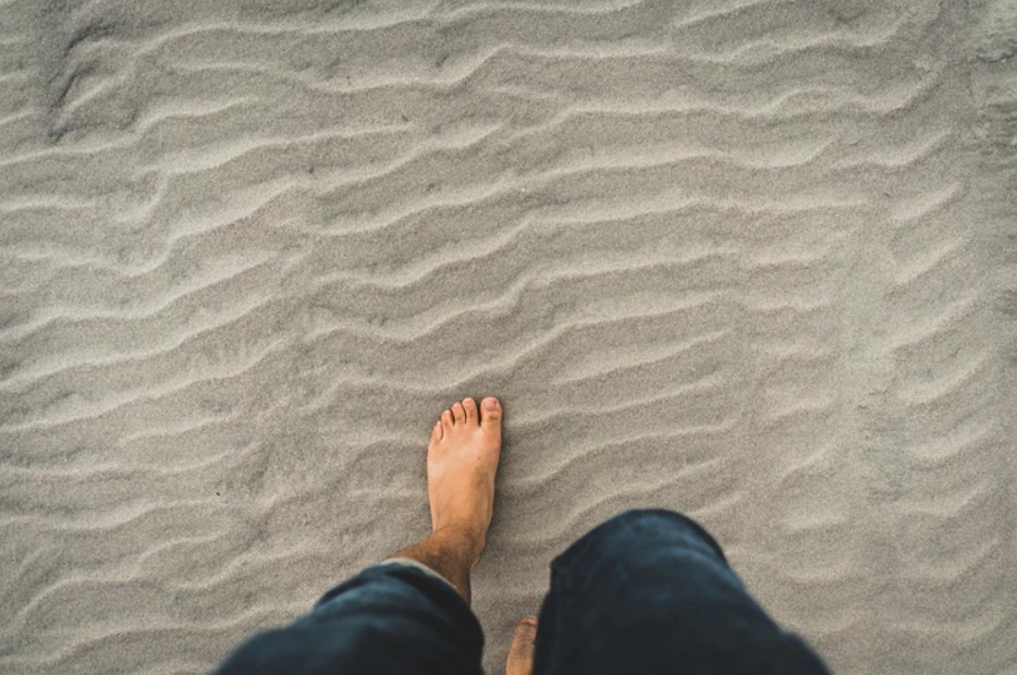 A man walking on the sand